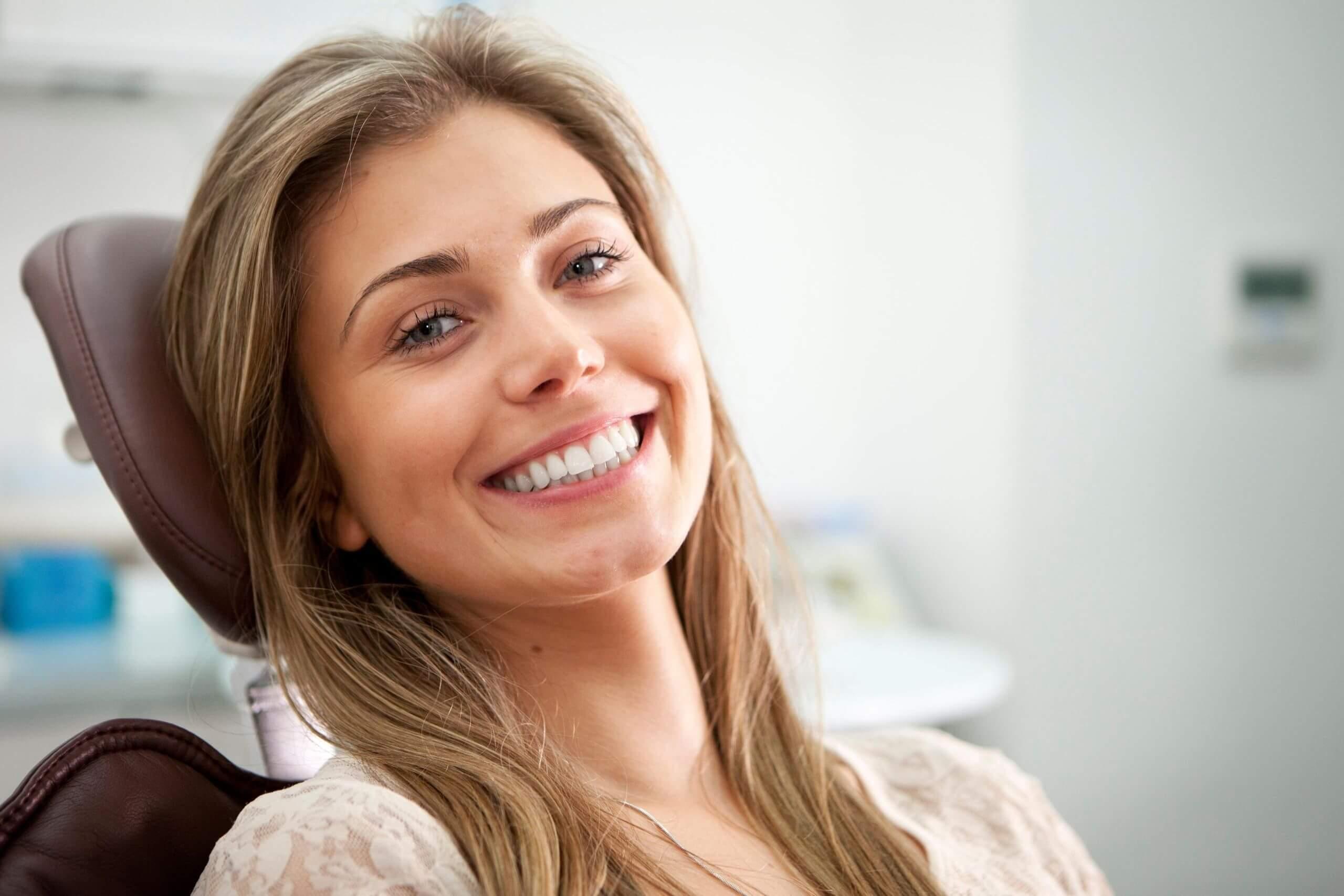 Women in dentist chair smiling