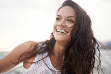 Brunette women with white teeth smiling