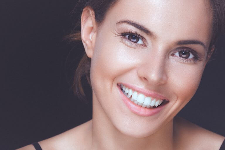 Women with white teeth smiling