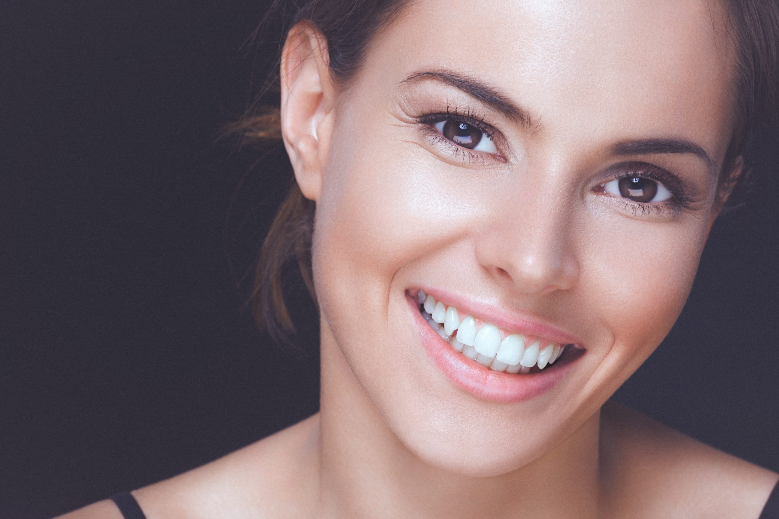 young woman with perfect smile and clean healthy skin