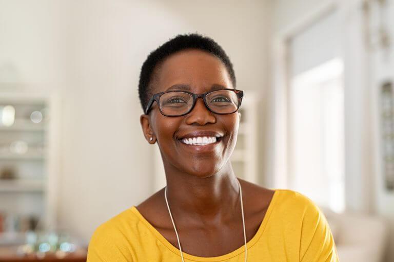 Women wearing glasses smiling